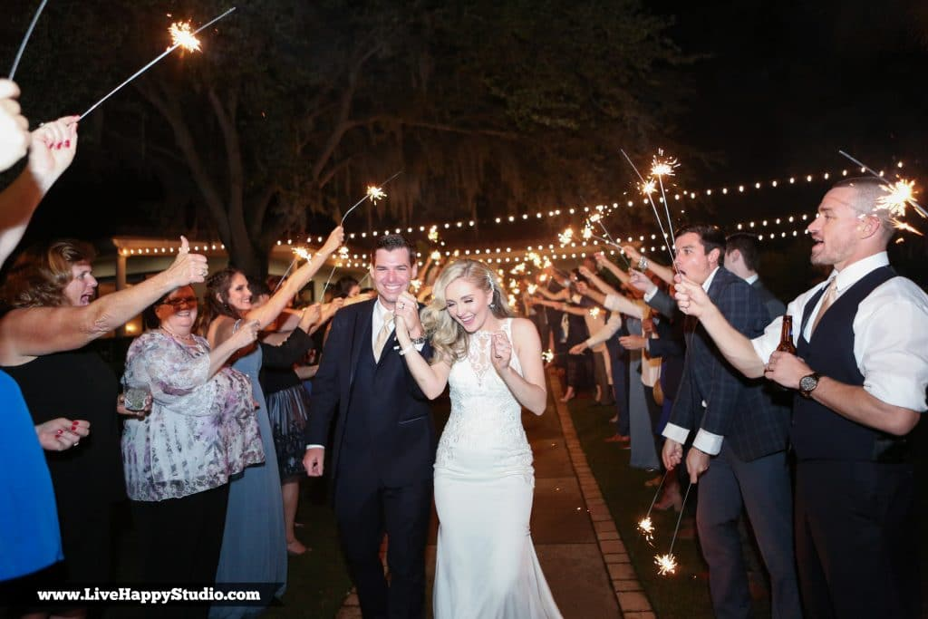 Bride and groom during nighttime sparkler sendoff