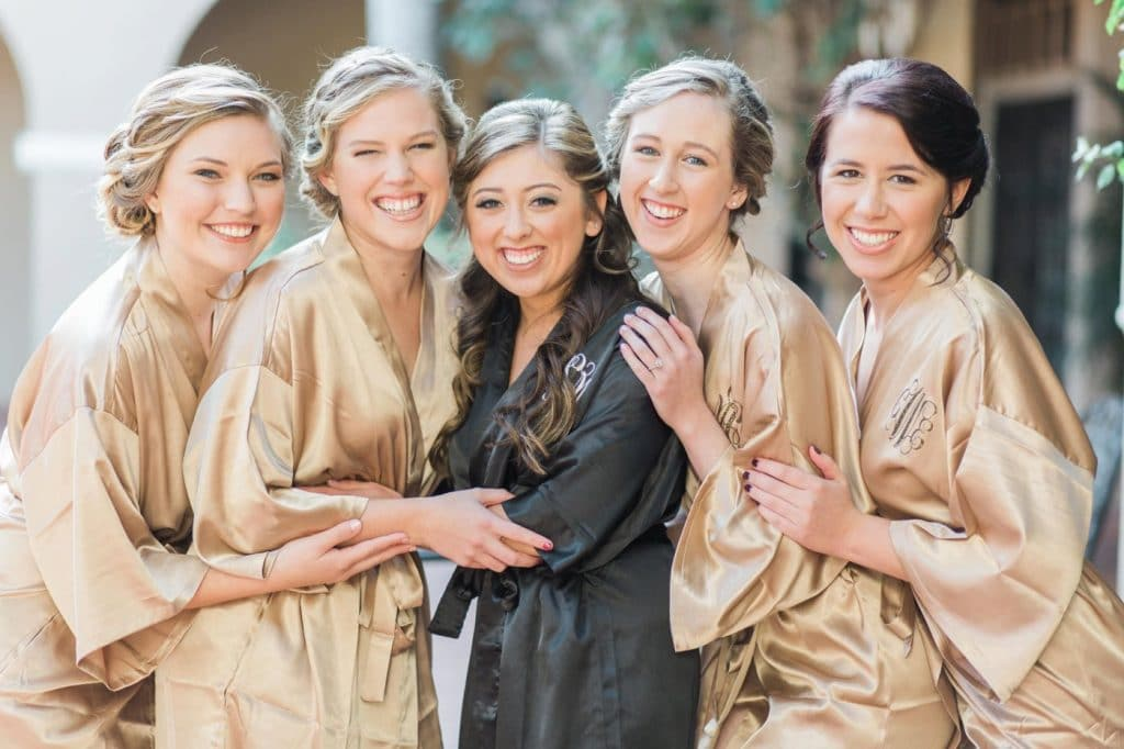 Bride and bridesmaids in coordinating robes