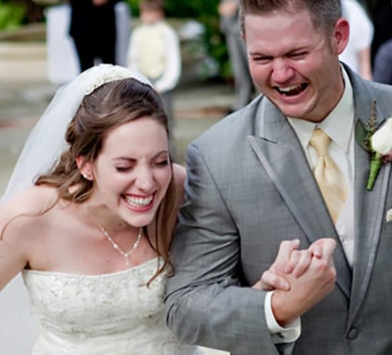 Amanda and Levi laughing down the aisle