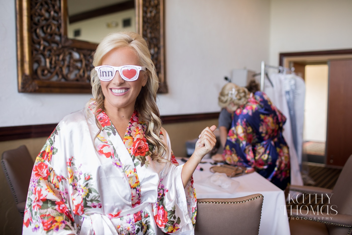 Bride in floral robe with Mission Inn sunglasses