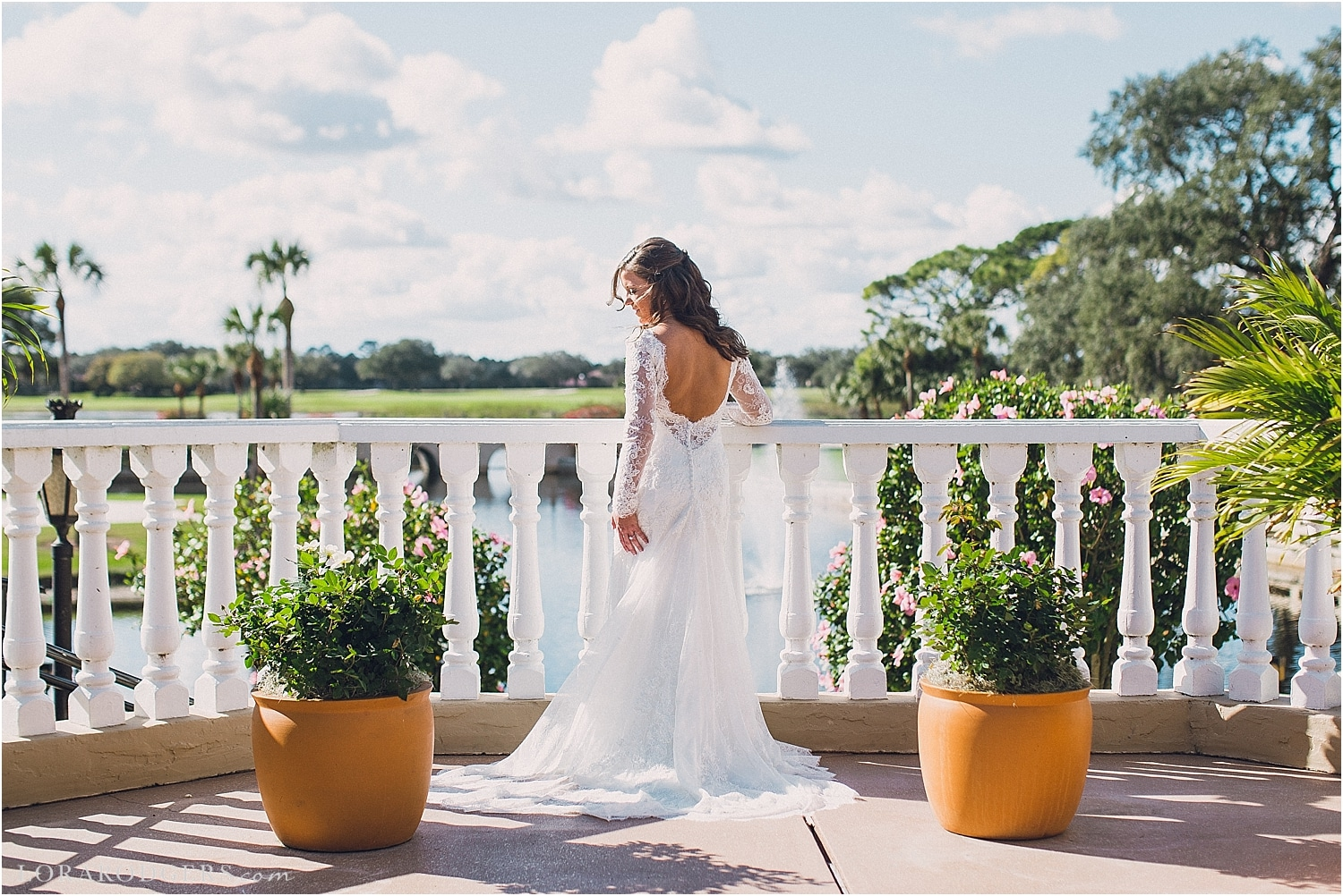 Bride in Plaza de la Fontana in backless longsleeved wedding gown