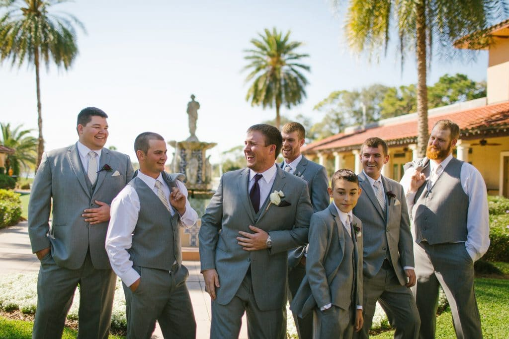 Groom and groomsmen hanging out in Plaza de la Fontana