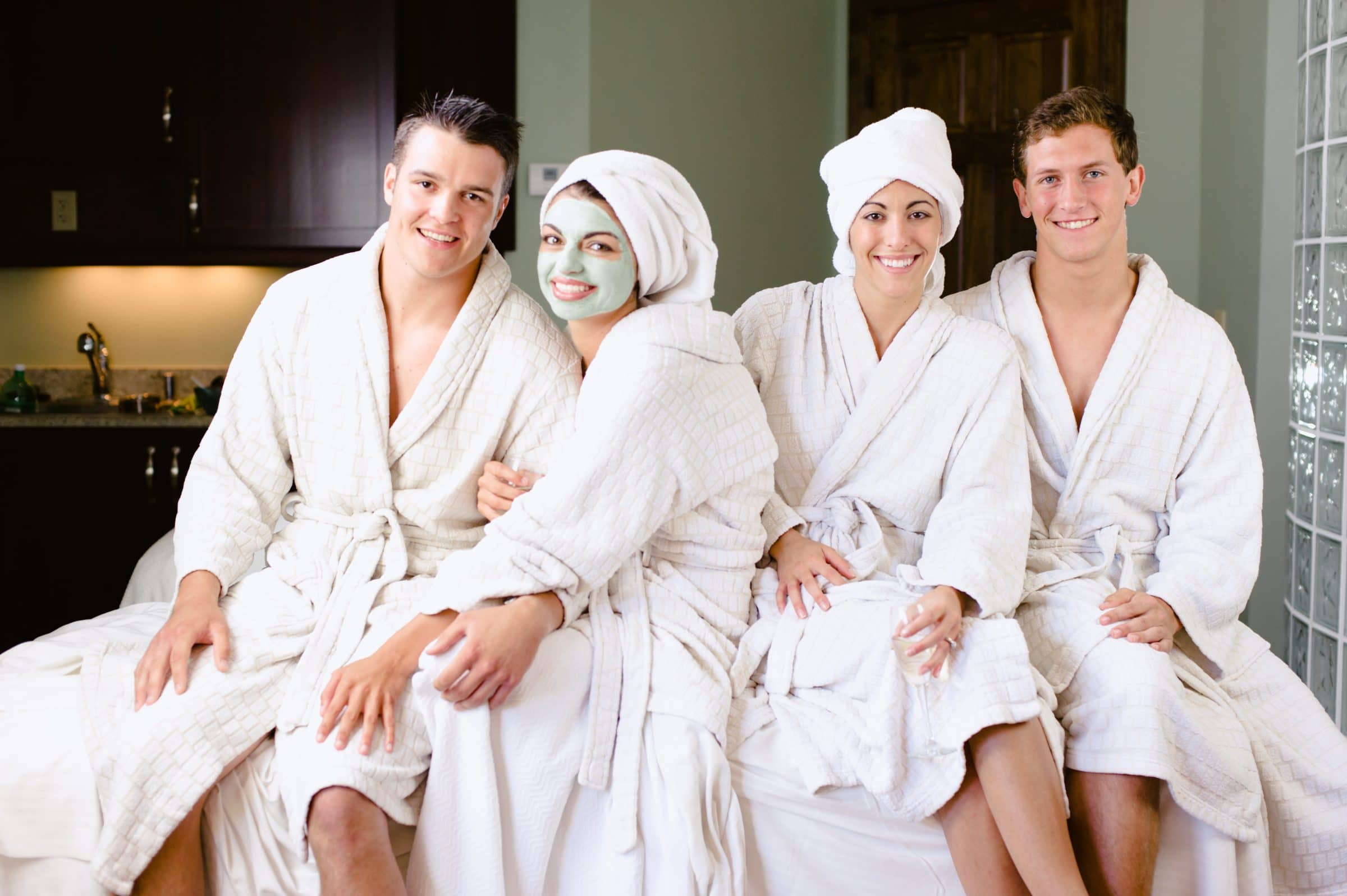 Two couples in spa robes