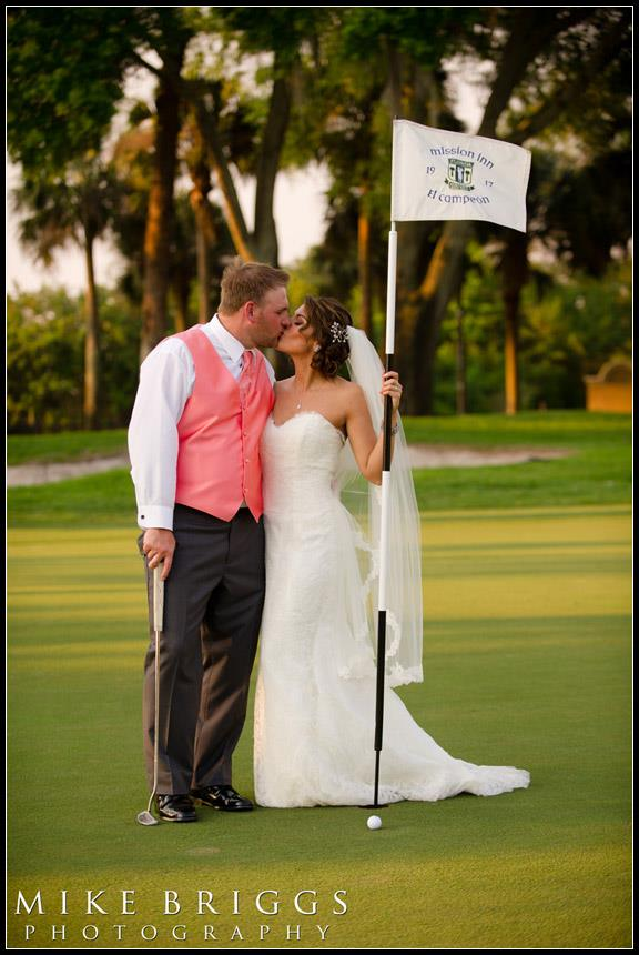 Bride and groom kissing while playing golf