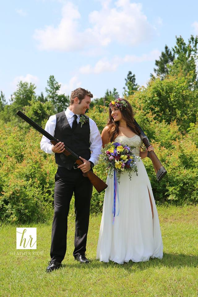 Bride and groom with rifles