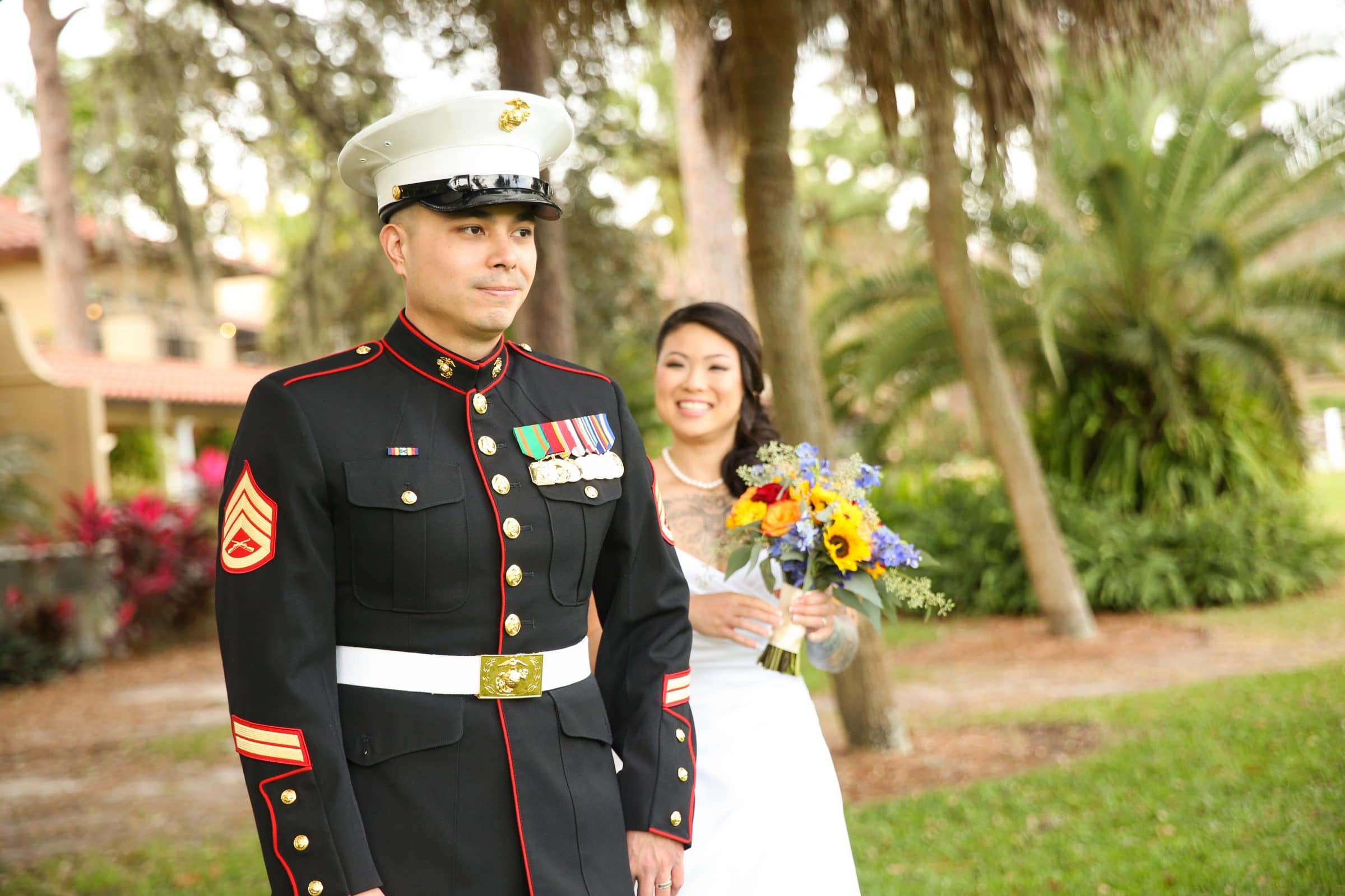 Smiling bride approaching military groom for first look