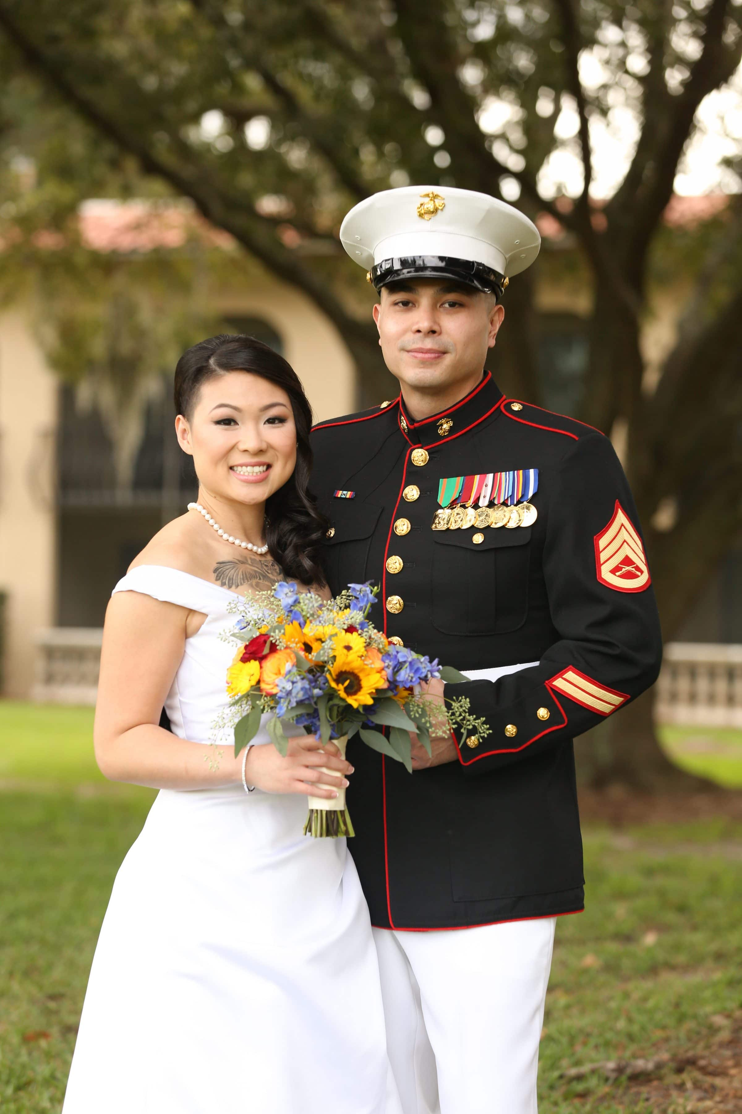 Smiling bride and military groom