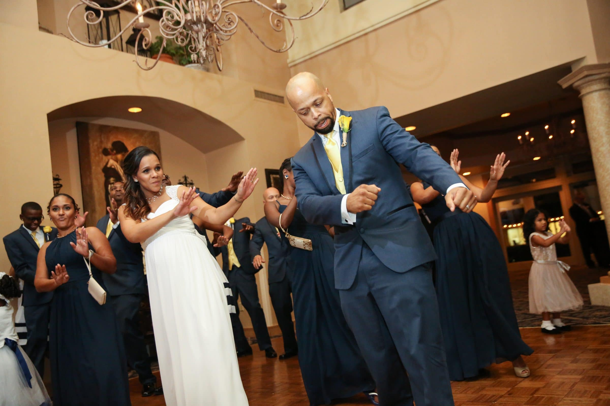 Bride and groom doing line dance at wedding reception