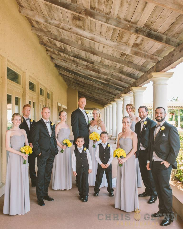 Wedding party under rustic porch ceiling