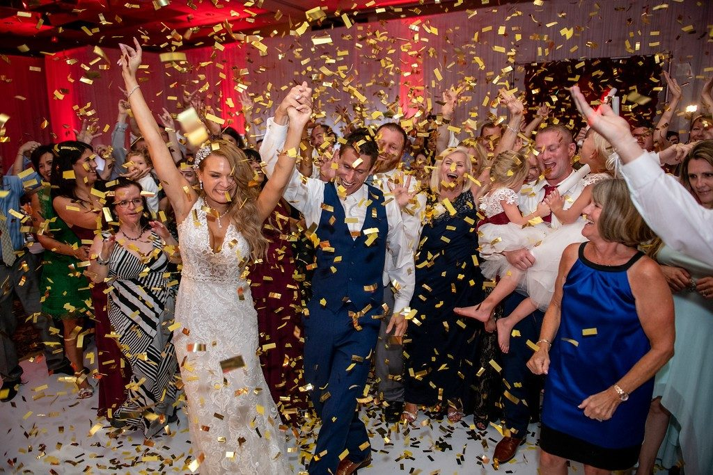 The Grand Ballroom - bride and groom with wedding guests in a shower of gold confetti