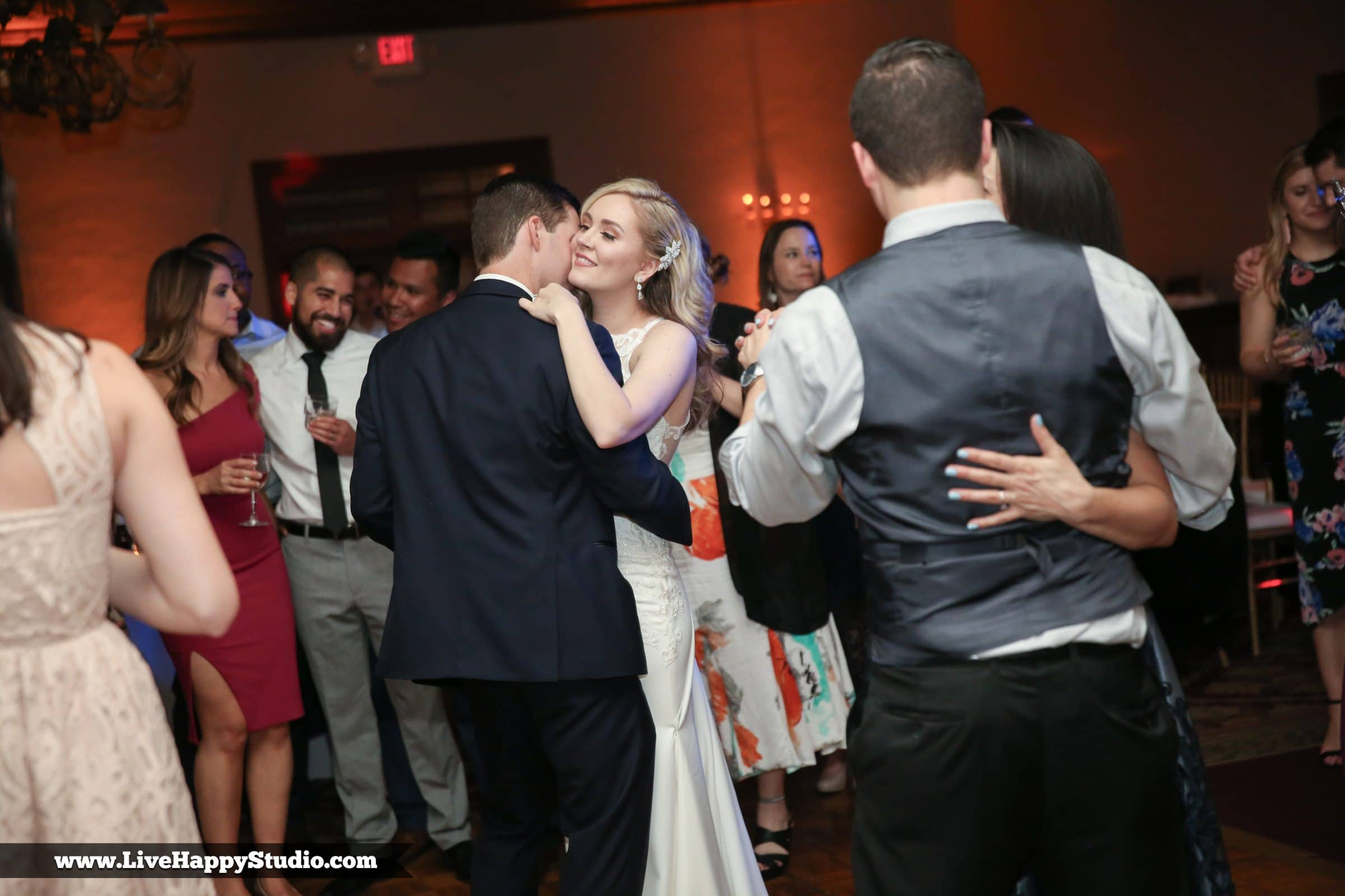 Bride and groom slow dancing at wedding reception