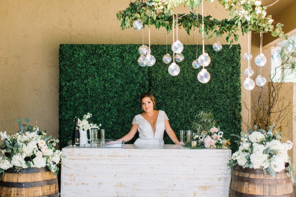 Beautiful bride behind rustic chic bar in the Legends Ballroom