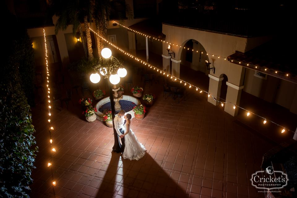 Aerial shot of bride and groom leaning against lamppost in the Plaza de las Palmas