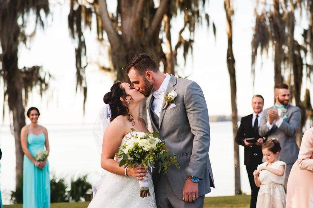 Bride and groom kissing at Marina del Rey