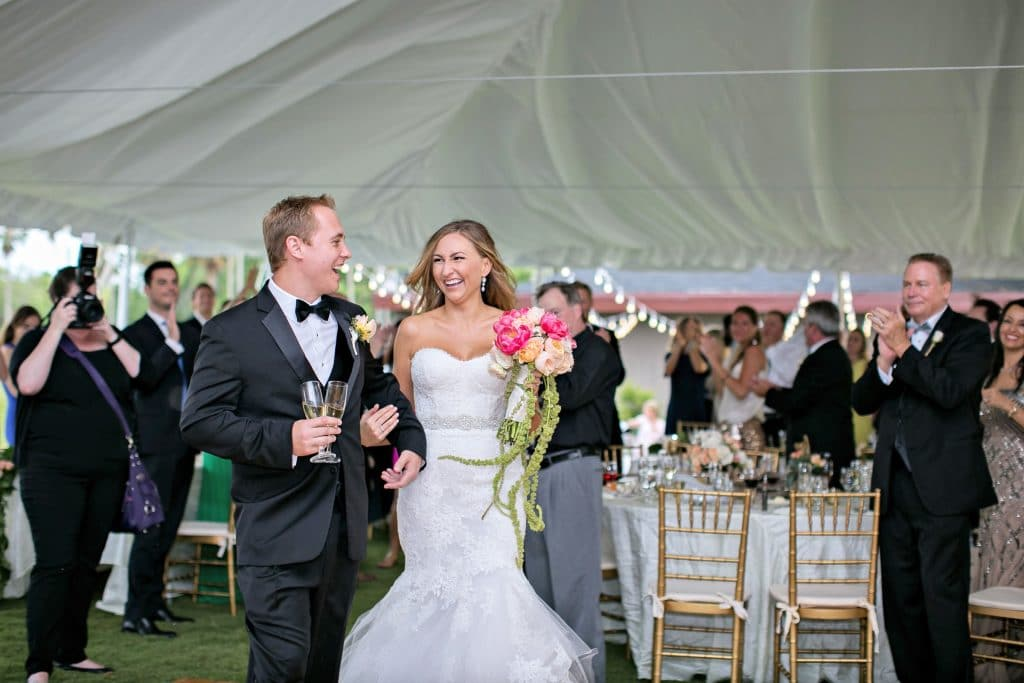 bride and groom announcement under outdoor reception tent