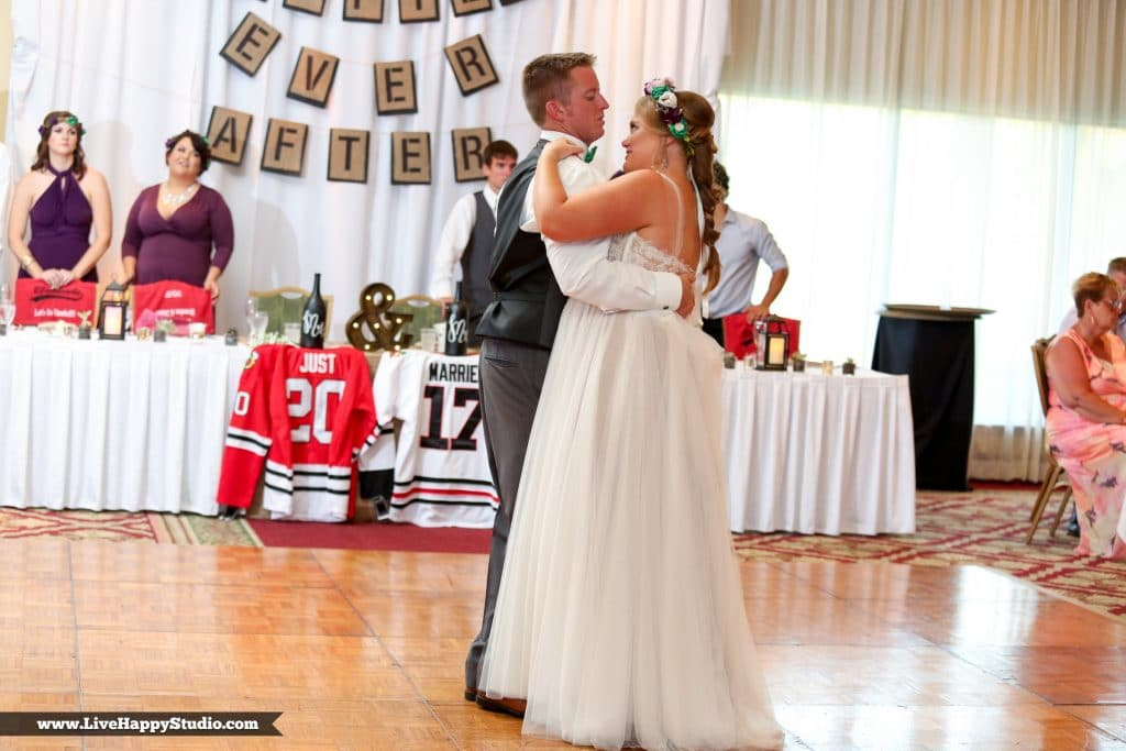 Bride and groom sharing first dance in front of