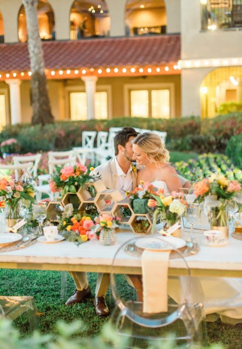 bride and groom at sweetheart table outdoors