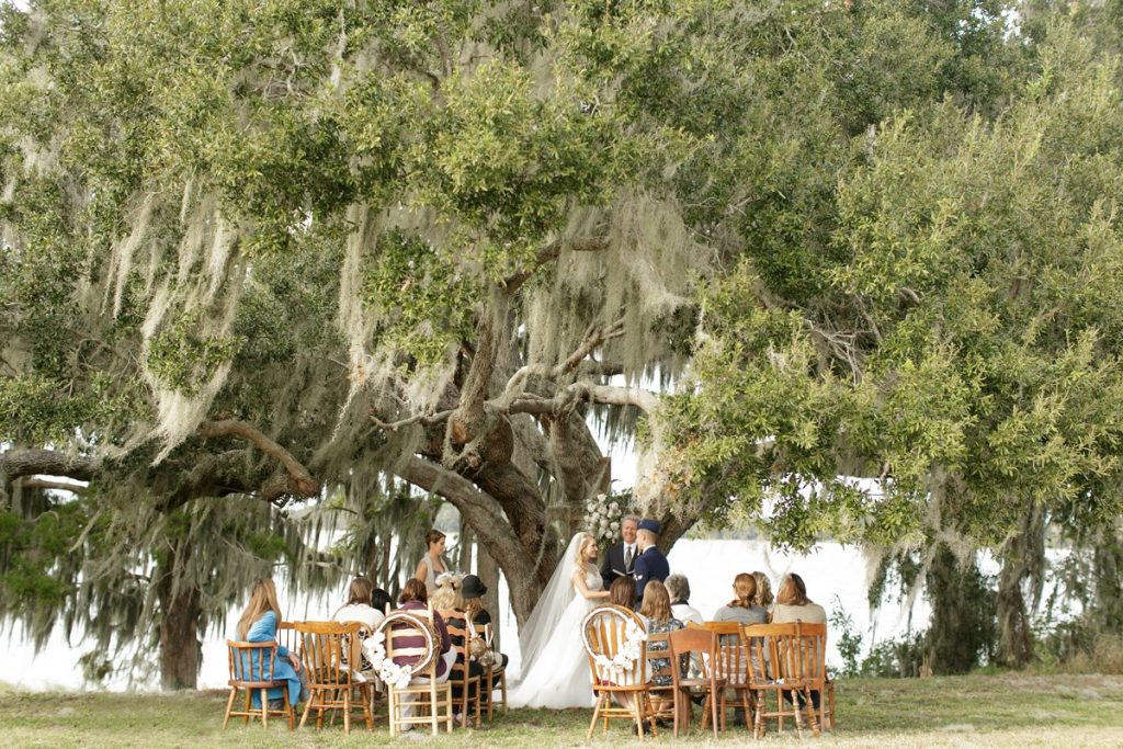 Marina del Rey - intimate wedding ceremony with mismatched chairs under oak tree