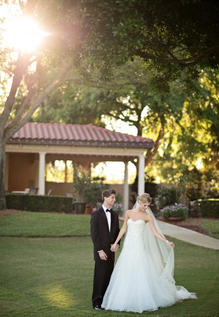Legends Courtyard - bride and groom walking the grounds