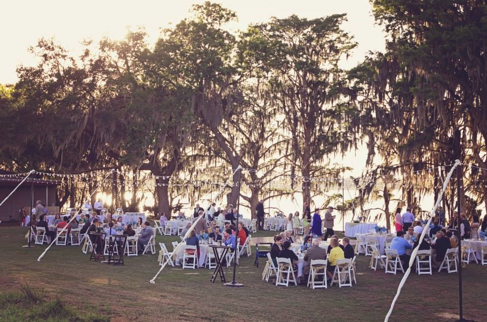 outdoor wedding reception with market lighting lakeside