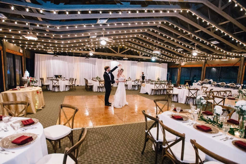 Bride and groom share dance in empty reception hall at Marina del Rey