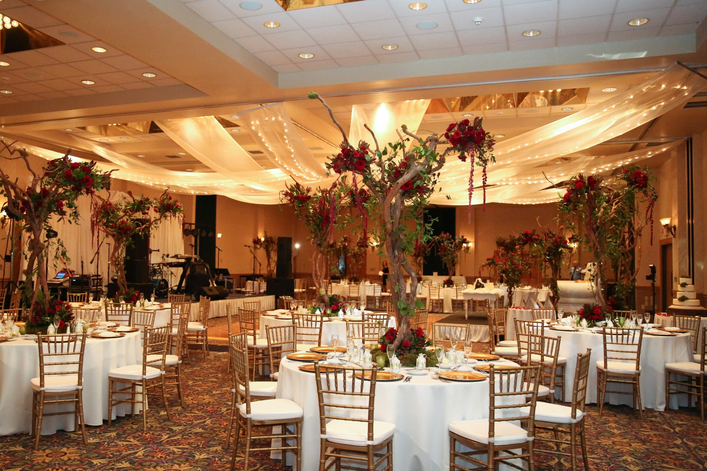 Wedding reception with tall, rustic, floral centerpieces an example of choosing your venue based on style
