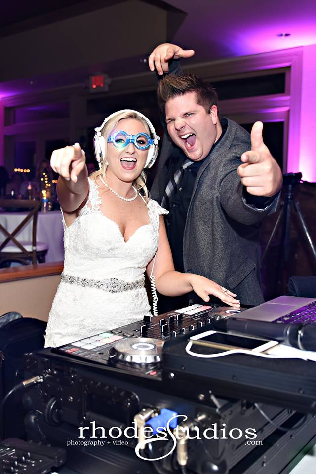 Bride and DJ behind the DJ booth