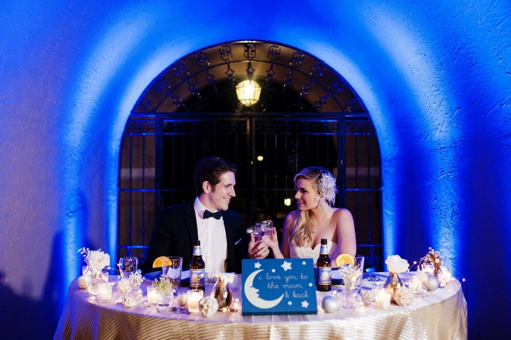 Bride and groom at moon themed sweetheart table