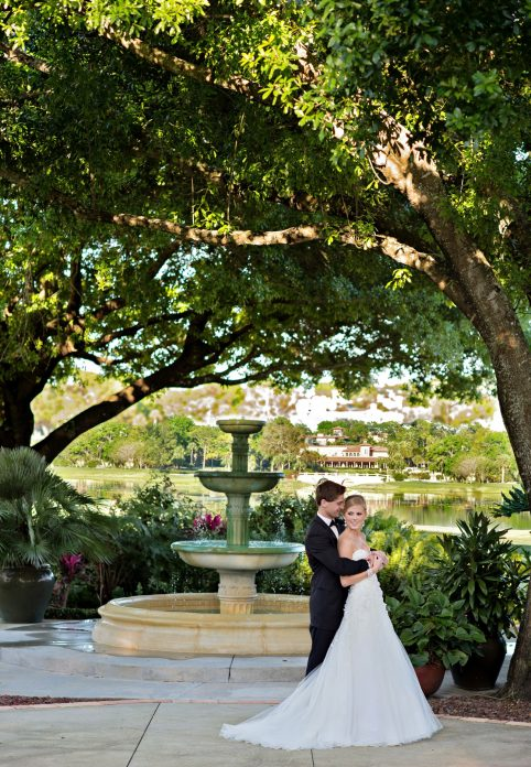 Legends Courtyard - bride and groom beside fountain