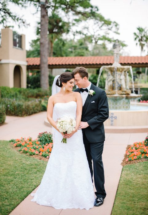 Bride and groom in beautiful outdoor courtyard