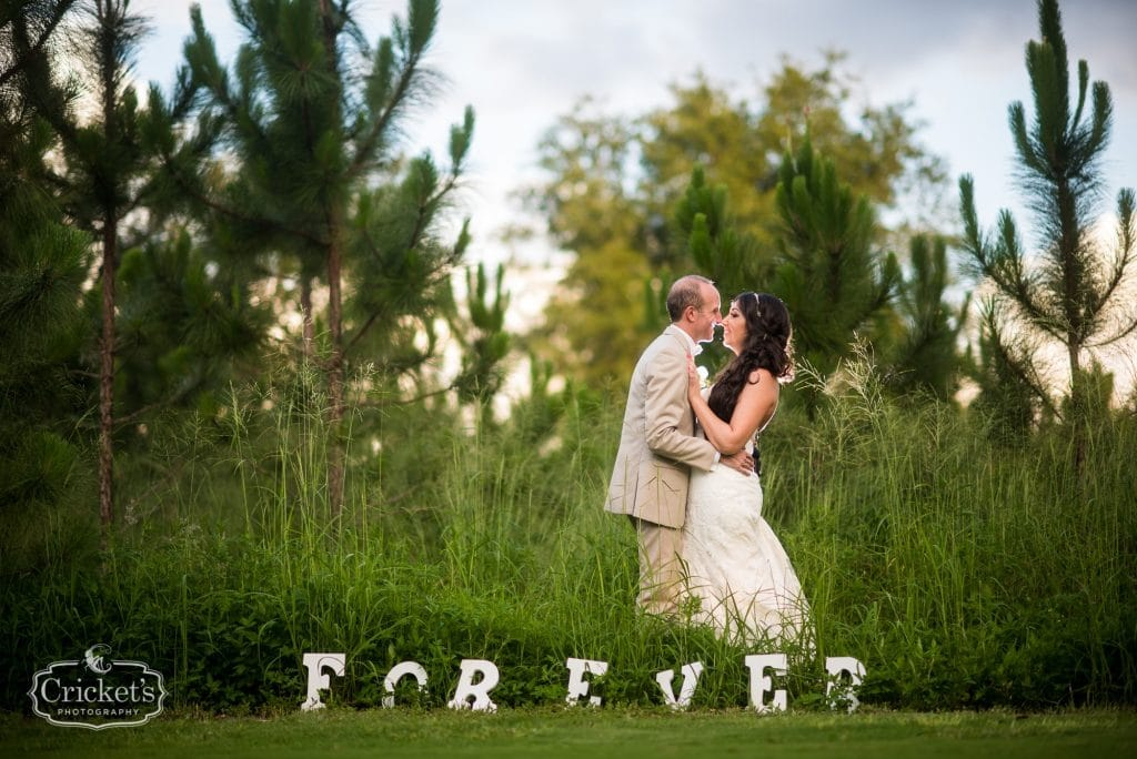 Marina del Rey - bride and groom kiss in grass with