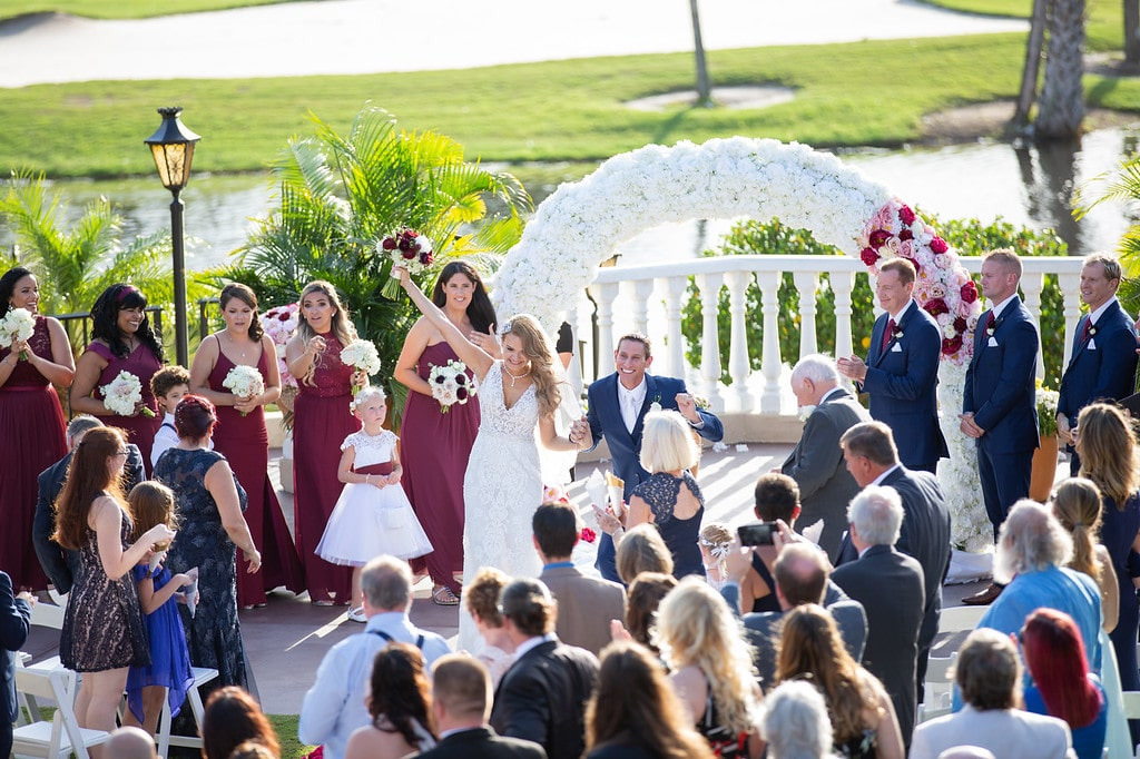 Plaza de la Fontana - wedding ceremony with floral archway