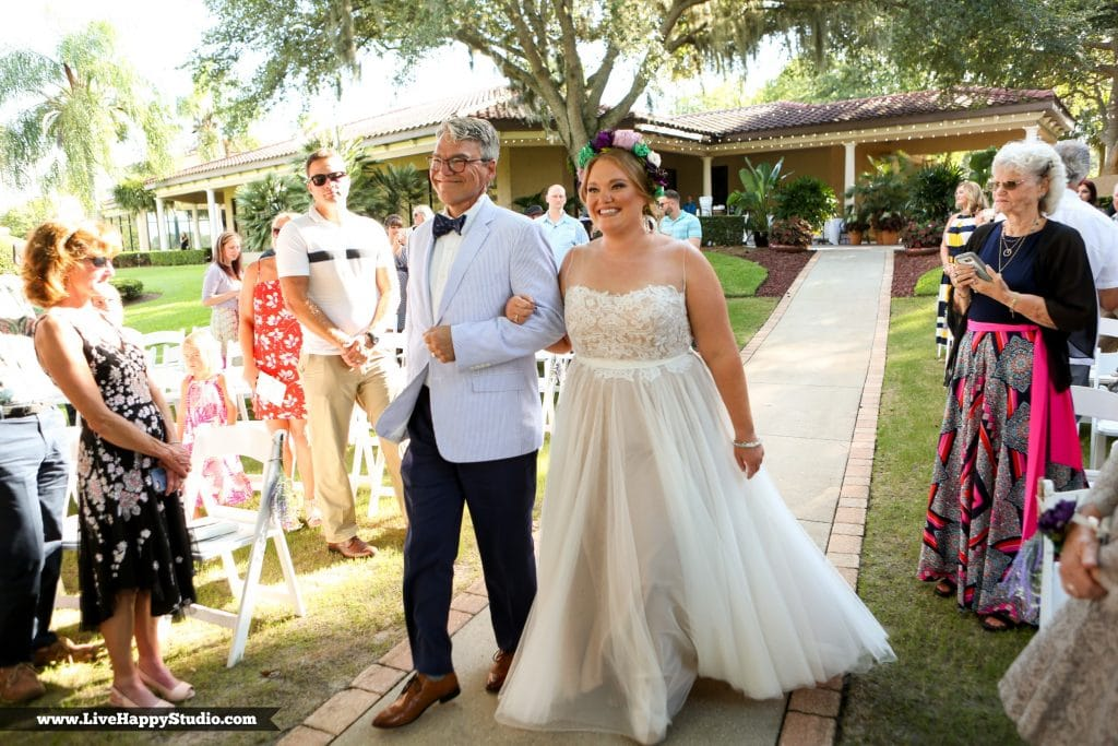 Legends Courtyard - bride being walked up the aisle