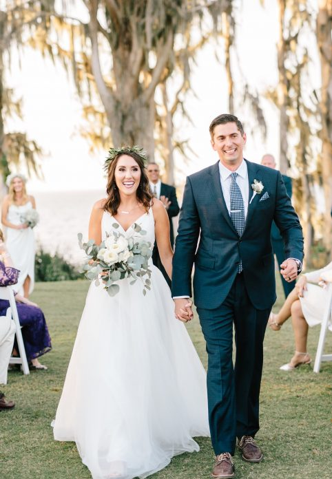 Marina del Rey - bride and groom walk down aisle with lake in background
