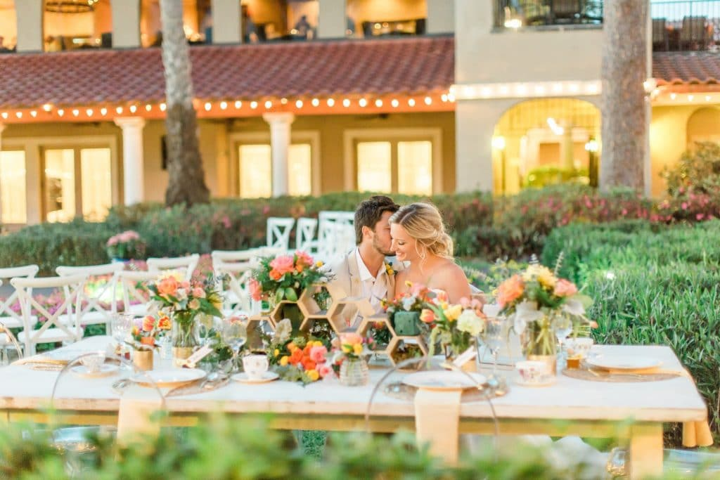 bride and groom at beautiful outdoor sweetheart table