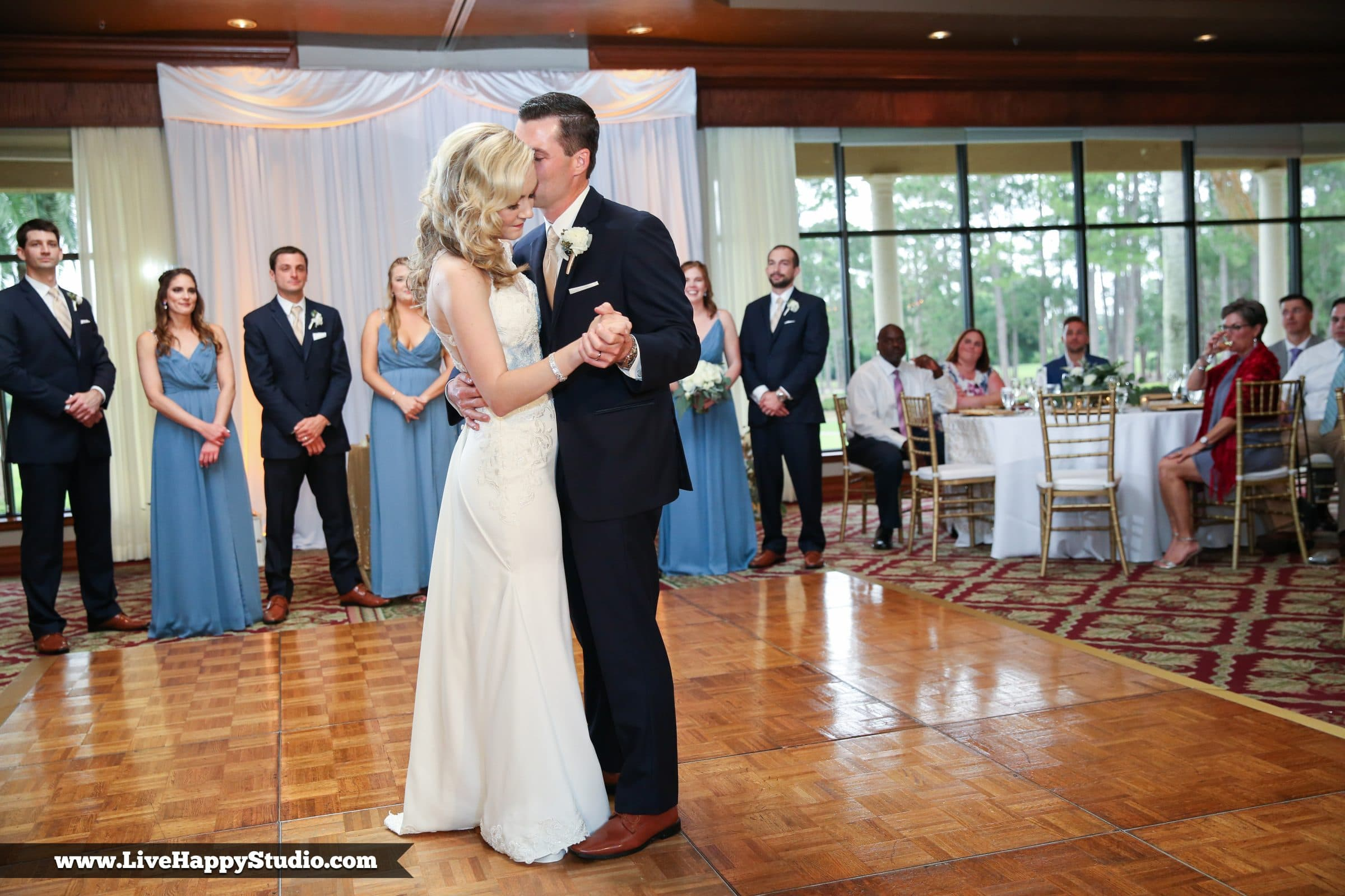 Groom kissing bride on cheek during first dance