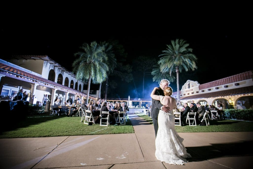 Bride and groom sharing first dance at Plaza de la Fontana