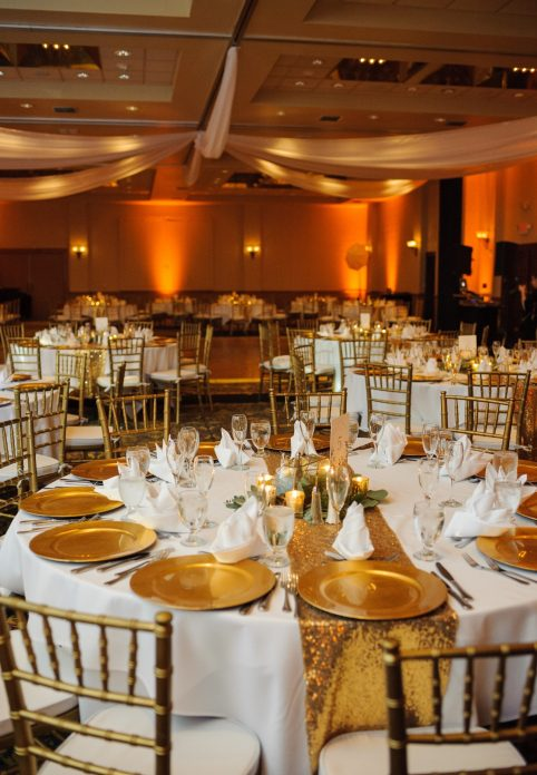 The Grand Ballroom - gold and glitter reception tables