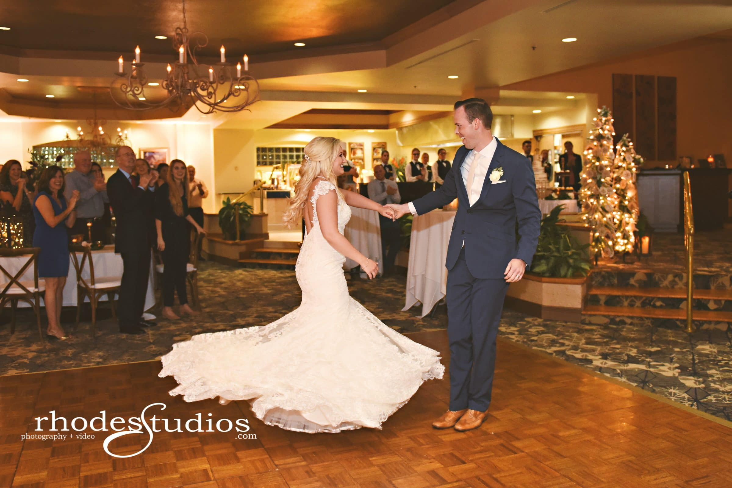 Groom twirling bride in mermaid dress