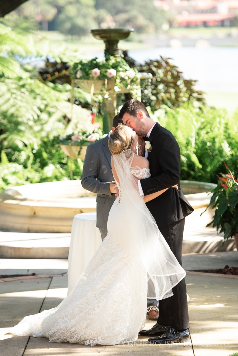 Bride and groom share first kiss at the Legends Courtyard