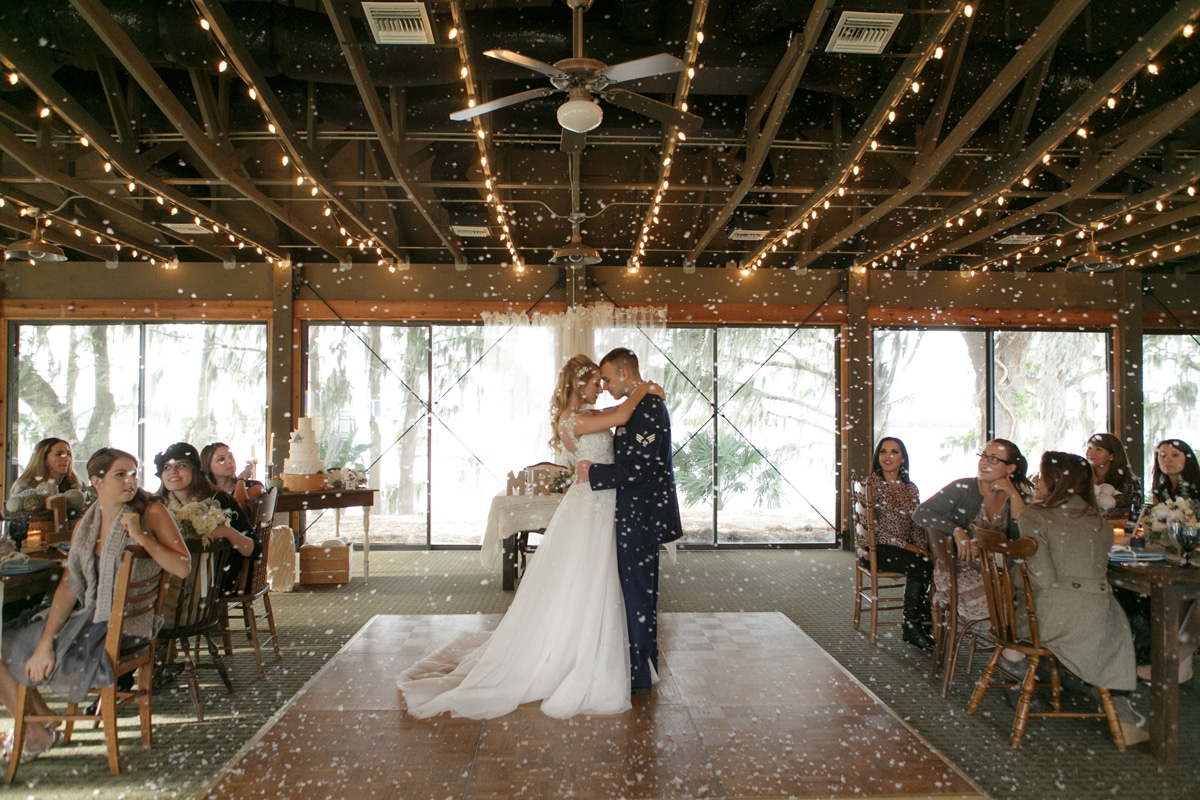Bride and groom share first dance at Marina del Rey under fake snow