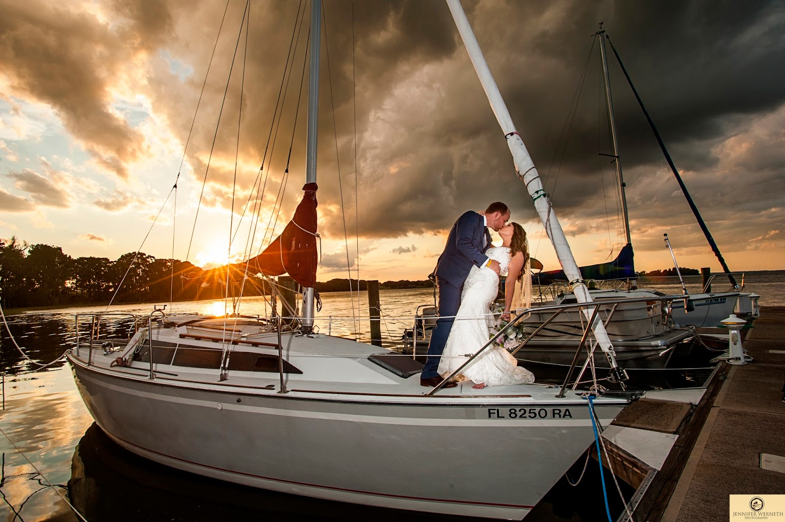 Bride and groom kissing on boat at Marina del Rey