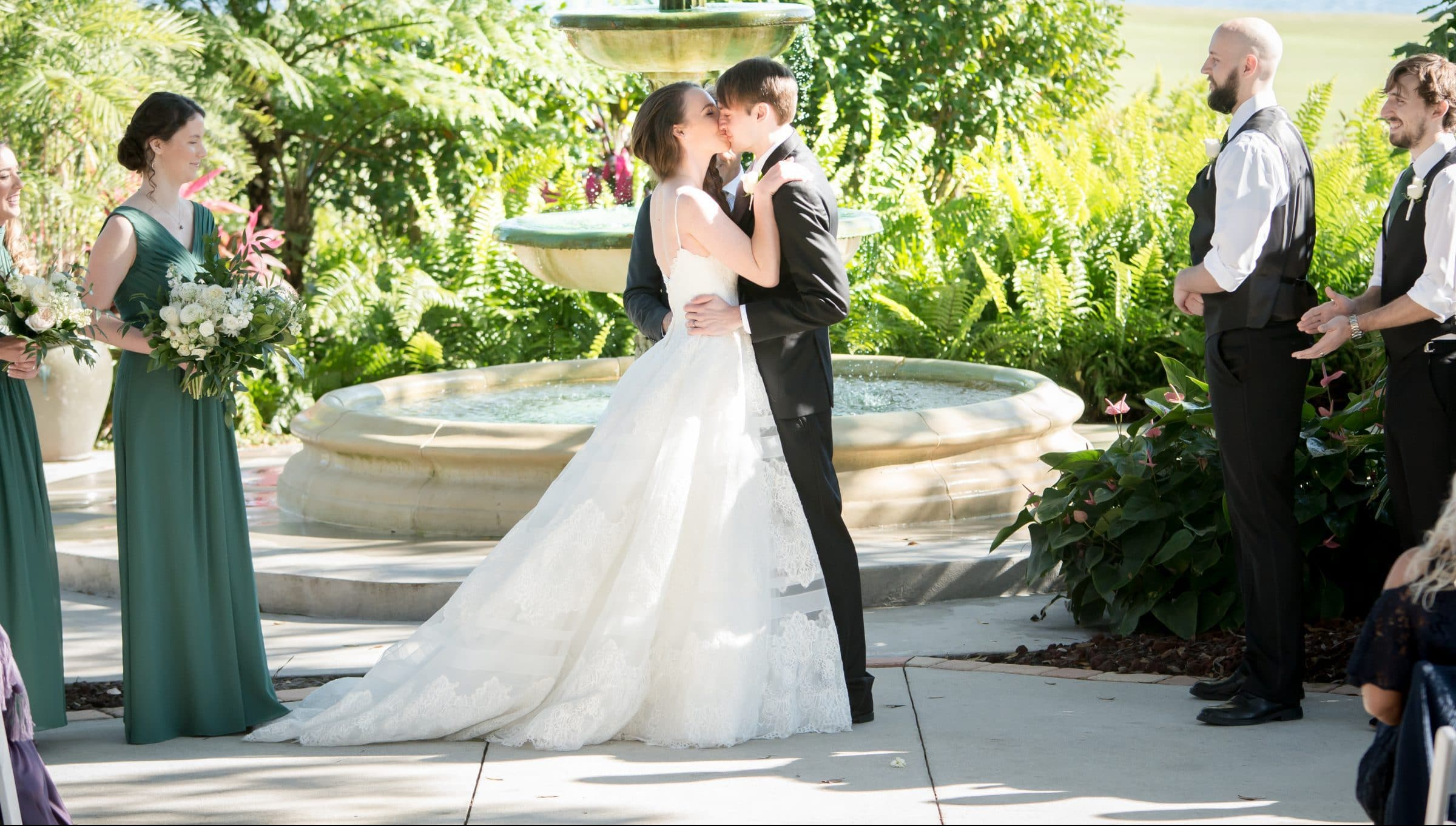 Bride and groom share first kiss in Legends Courtyard