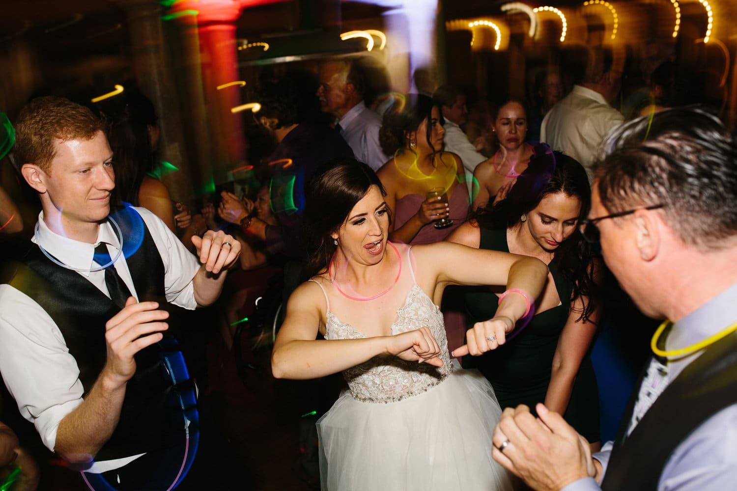 bride and guests party with glow sticks