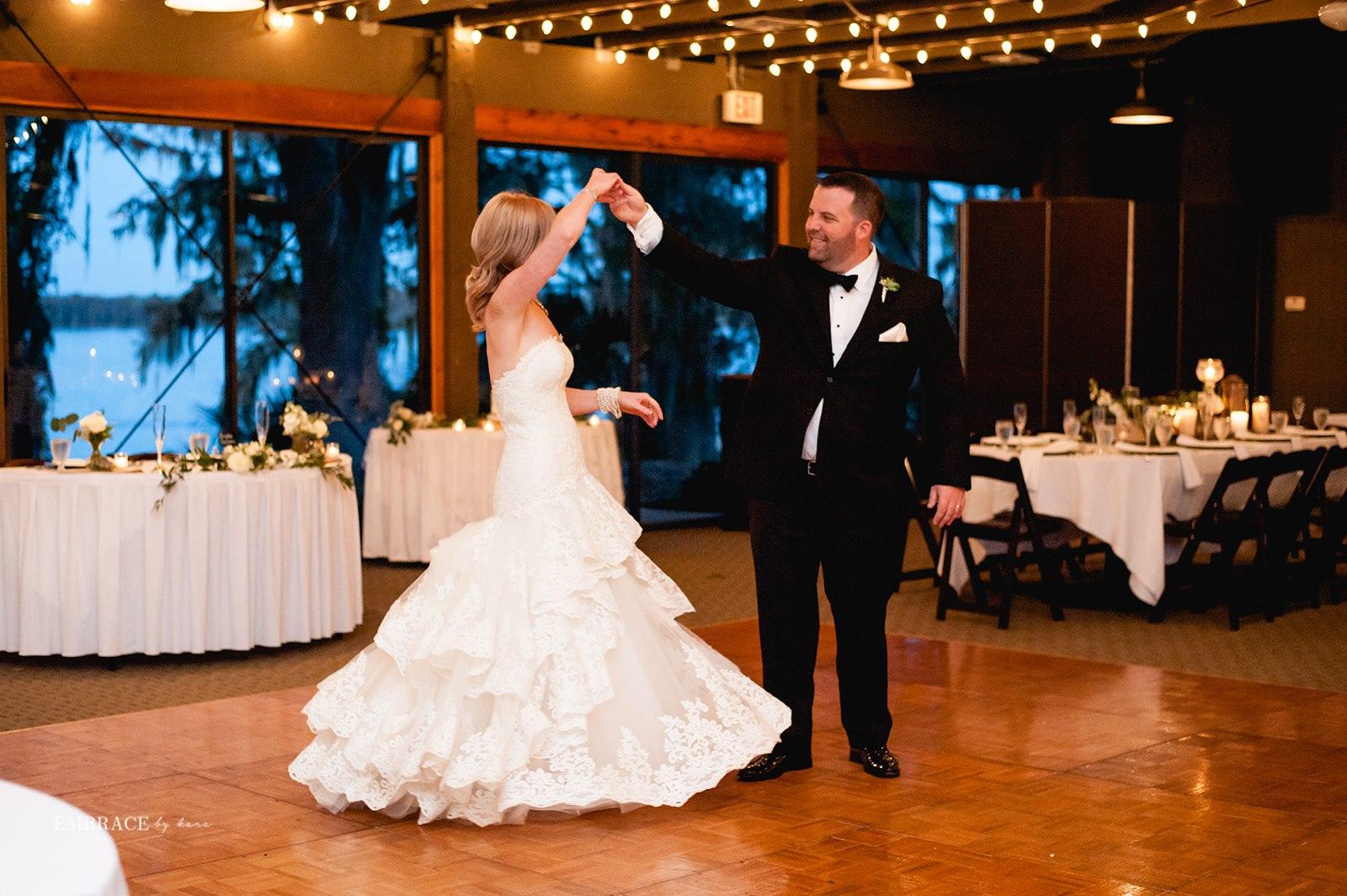 Groom spinning bride in empty reception hall at Marina del Rey