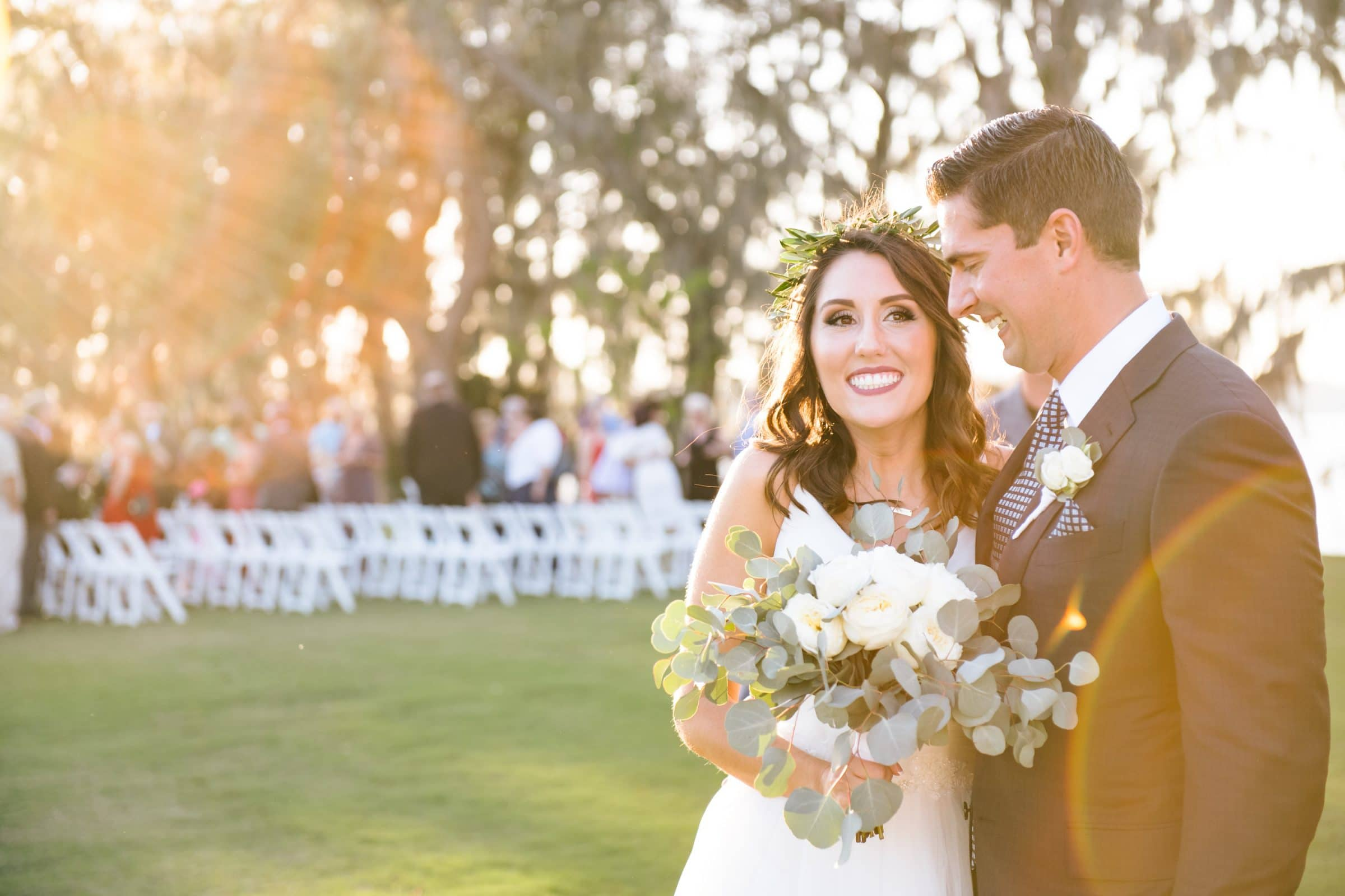 Boho chic bride next to laughing groom at Marina del Rey