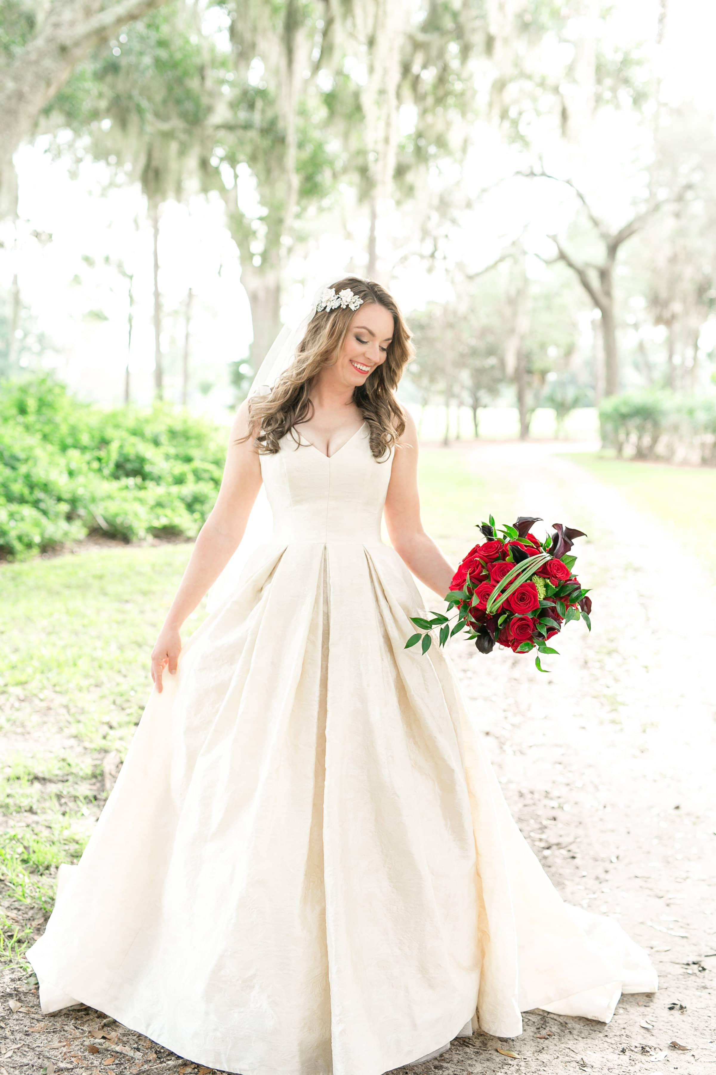 Beautiful bride with red bouquet