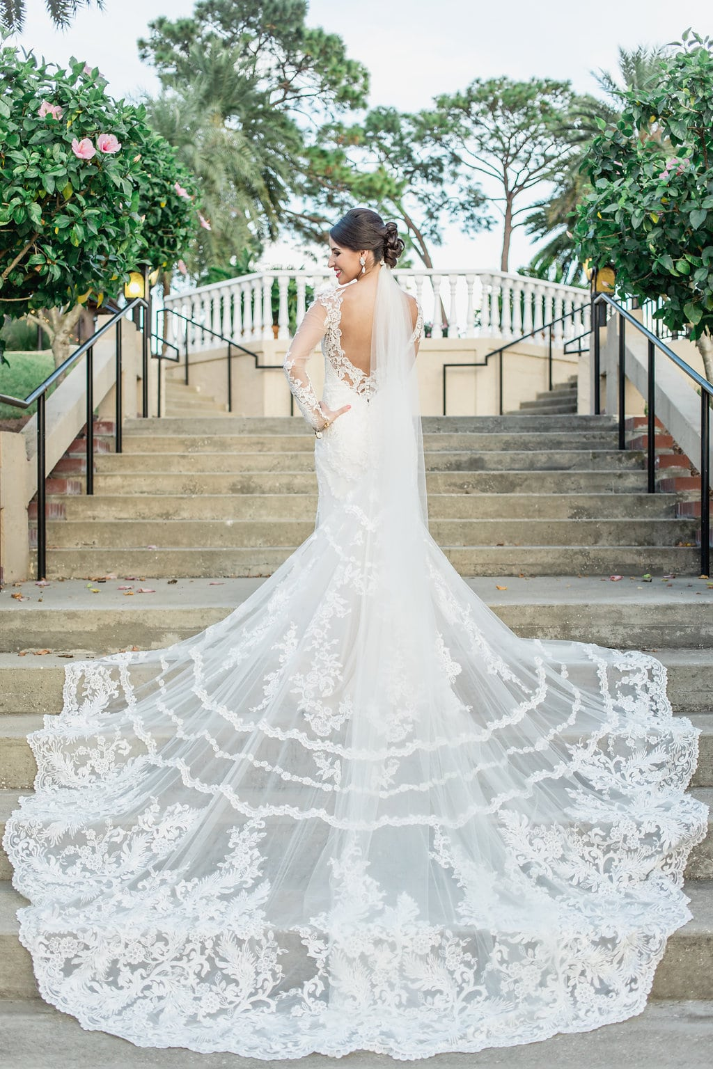Stunning intricate lace train spread out on staircase