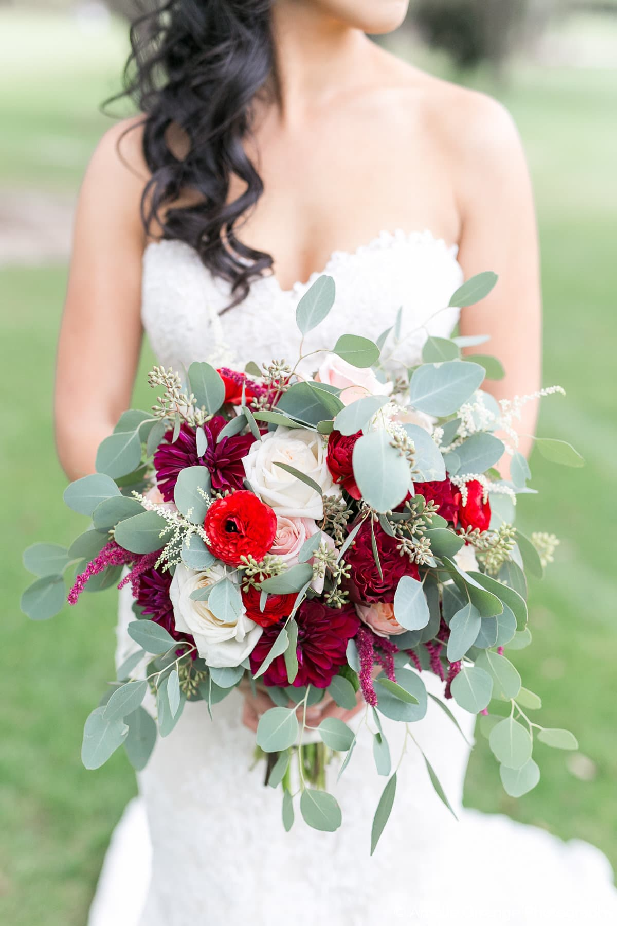 bride holding eucalyptus bouquet