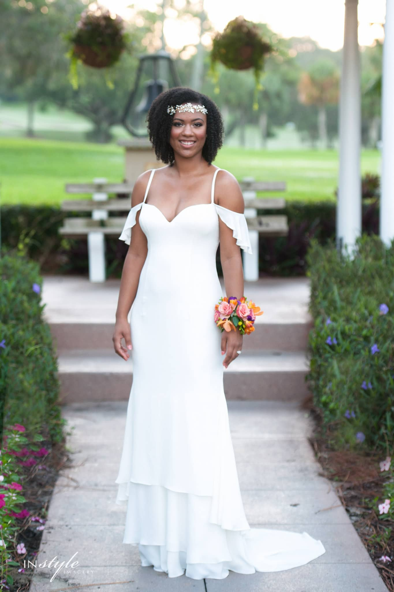 Lovely African American bride in simple sheath dress